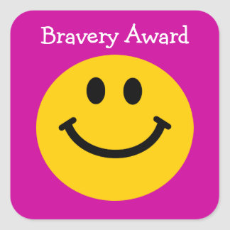 Bravery award yellow smiley face on pink sticker