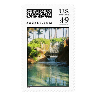Brdige over small waterfall postage
