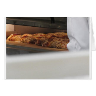 Bread freshly made into the oven card
