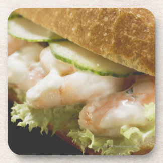 Bread roll filled with shrimps, cucumber and beverage coaster