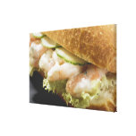 Bread roll filled with shrimps, cucumber and canvas print