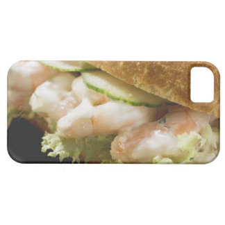 Bread roll filled with shrimps, cucumber and iPhone 5 cover