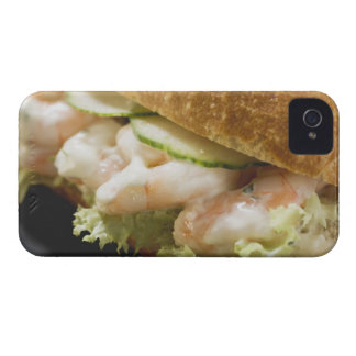 Bread roll filled with shrimps, cucumber and iPhone 4 cover
