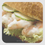 Bread roll filled with shrimps, cucumber and square sticker