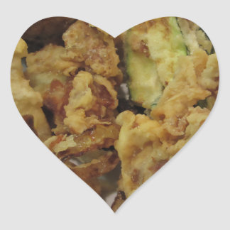 Breaded and fried crunchy vegetables with lemon heart sticker