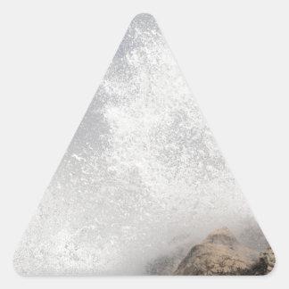 Breaking waves on rocks on the Adriatic Sea. Triangle Sticker