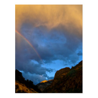 BREATHTAKING RAINBOW THROUGH RAIN CLOUDS AT SUNSET POSTCARD