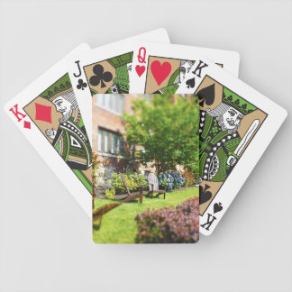 Brick Home, Adirondack Wooden Chairs, Shrubs Plaza Bicycle Playing Cards
