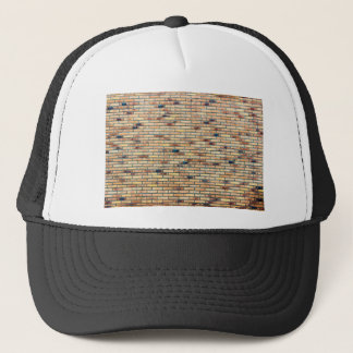 Brick wall with several colors trucker hat