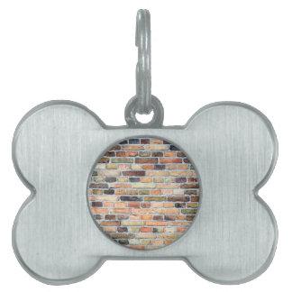Brick wall with various colors pet name tag