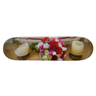 Bridal bouquet and wedding rings skate board deck