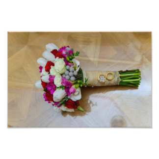 Bridal bouquet and weeding rings photograph