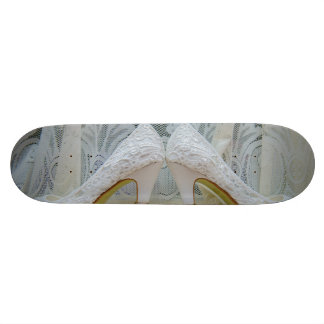 Bridal shoes and wedding rings skate boards