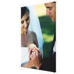 Bride and groom holding hands, close-up stretched canvas print
