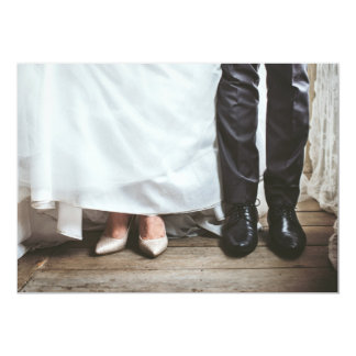 Bride and groom legs on wedding invitation