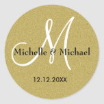 "Bride And Groom Monogram Gold Glitter Classic Round Sticker<br><div class=""desc"">Custom couple names Monogrammed Wedding envelope seal in shimmery gold adds the right touch of elegance to your wedding mail.The custom Monogram Stickers can be used for your other wedding related mails too.The stylish Monogrammed Stickers look great as seals on party favors, thank you cards, gifts, etc .The glitter gold...</div>"