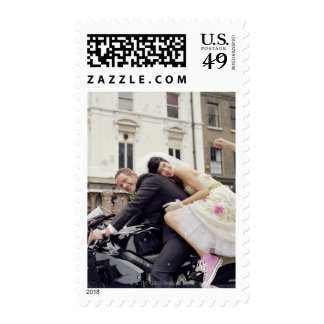 Bride and groom on motorbike, smiling, portrait stamps