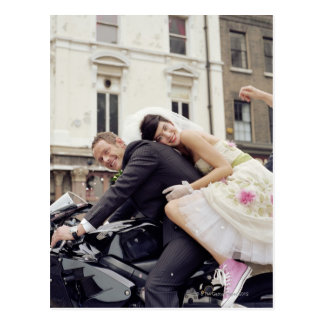 Bride and groom on motorbike, smiling, portrait postcard
