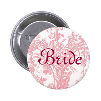 Bride button on pretty pink floral background