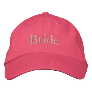 Bride cap in pastel pink with dark pink font embroidered hats