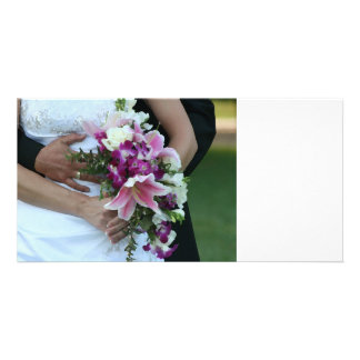 bride holding flowers groom behind painting photo card