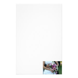 bride holding flowers groom behind painting stationery paper
