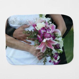 bride holding flowers groom behind painting burp cloth