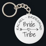 "Bride Tribe bachelorette party favor keychains<br><div class=""desc"">Bride Tribe party favor round button keychains for wedding, bridal shower, engagement or bachelorette parties. Cute favor gift idea for brides entourage; bridesmaids, maid of honor, flower girl, mother of the bride, sister, cousin, mom, friends, family members etc. Trendy accessory with vintage typography and feather &amp; heart arrow. Beautiful tribal...</div>"