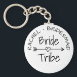 """Bride Tribe bachelorette party favor keychains<br><div class=""""desc"""">Bride Tribe party favor round button keychains for wedding, bridal shower, engagement or bachelorette parties. Cute favor gift idea for brides entourage; bridesmaids, maid of honor, flower girl, mother of the bride, sister, cousin, mom, friends, family members etc. Trendy accessory with vintage typography and feather &amp; heart arrow. Beautiful tribal...</div>"""