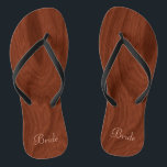"""Bride Wedding Day Rustic Wood Look Beach Honeymoon Flip Flops<br><div class=""""desc"""">Rustic wood look bride flip flop thong sandals perfect for beach weddings- Reads Bride in elegant style, pastel pink letters at the bottom. Elegant, rich mahogany wood look woodgrain pattern background. Note: Wood is printed image. Rustic wedding favors for bridal party members. Just change text templates to create your own...</div>"""
