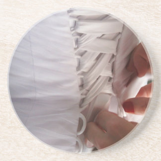 Bridesmaid hand lacing wedding dress photograph coaster