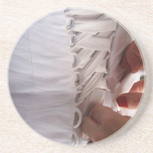 Bridesmaid hand lacing wedding dress photograph drink coasters