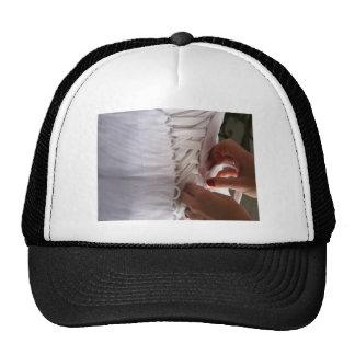Bridesmaid hand lacing wedding dress photograph trucker hat