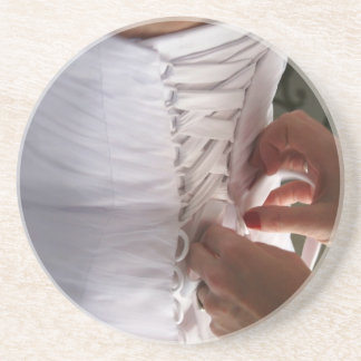 Bridesmaid hand lacing wedding dress photograph sandstone coaster