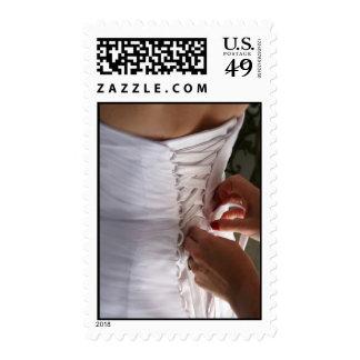 Bridesmaid hand lacing wedding dress photograph stamps