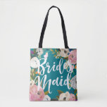 """Bridesmaids Brushed Floral Wedding Party Tote<br><div class=""""desc"""">Custom color background and all over printing with painted floral edges. Bridesmaid in brush script on one side and name on the back. Customize to change the background color (turquoise). Black looks amazing too. The gorgeous painted florals are by Create the Cut. Find them on Creative Market https://crmrkt.com/7WdAX, Etsy https://www.etsy.com/shop/CreateTheCut,...</div>"""