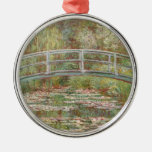 Bridge Over a Pond of Water Lilies Round Metal Christmas Ornament