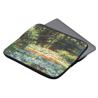 Bridge Over The Water Lily Pond by Claude Monet Laptop Sleeves