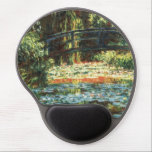 "Bridge Over the Waterlily Pond by Claude Monet Gel Mouse Pad<br><div class=""desc"">The Bridge Over The Water Lily Pond (1900) by Claude Monet is a vintage impressionism fine art floral nature painting. It is part of a series of Japanese footbridge paintings that Monet painted in his spring flower gardens in Giverny, France. About the artist: Claude Monet (1840-1926) was a founder of...</div>"