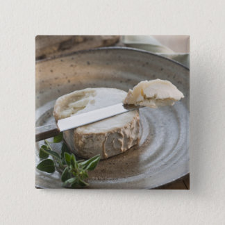 Brie cheese on plate button