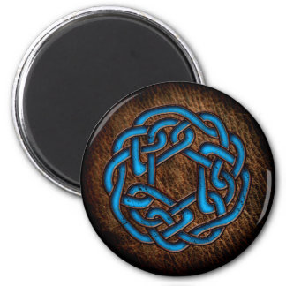 Bright blue celtic ornament on leather magnet