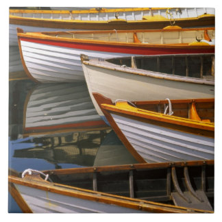 Bright colored boats at the Wooden Boat Center Ceramic Tile