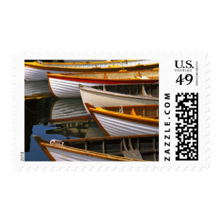 Bright colored boats at the Wooden Boat Center Postage