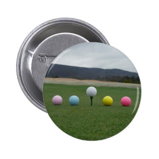 bright colored Golf Balls on a mountain Pins