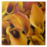 Bright colorful calla lilies at the ceramic tile