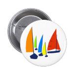 Bright colorful sailboats button