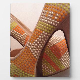 Bright coloured orange green yellow white shoes plaque