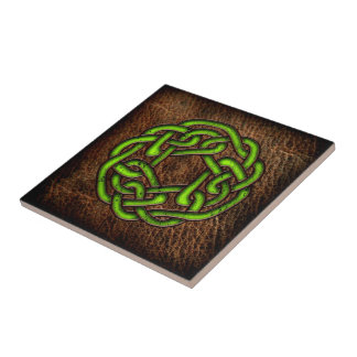 Bright green celtic knot on leather tile