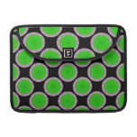 Bright green circles on black sleeve for MacBooks
