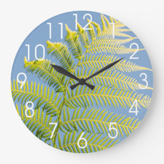 Bright Green Fern On A Blue Background Large Clock